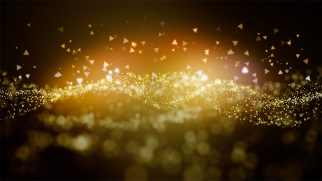 Cinematic golden glowing moving particles with floating lights. Magical dust with on clean background. Abstract motion of particles in 4K. Seamless loop.
