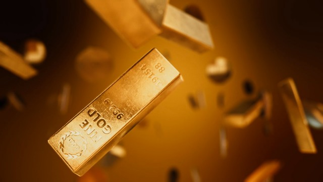 Shiny gold bars and coins falling from sky