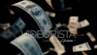 100 dollar bills falling in slow motion with Depth of Field camera Focus.