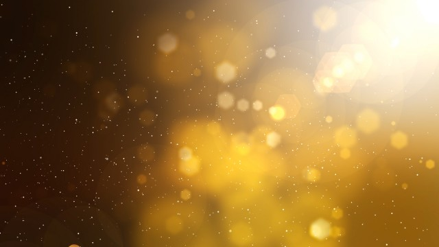 Golden abstract motion background with particles, lights and snow.