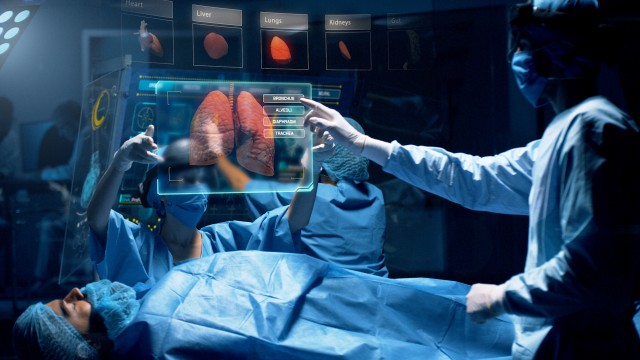 Doctor analyzing Lungs 3D Scan on a futuristic augmented reality lens.
