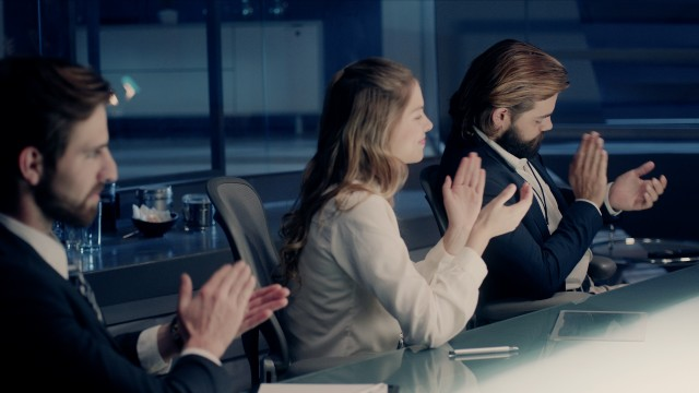 Professional Board of Executives and Clients Sitting at Corporate Meeting Room giving their applause in slow motion. Shot on ARRI ALEXA Mini UHD Cinema Camera.
