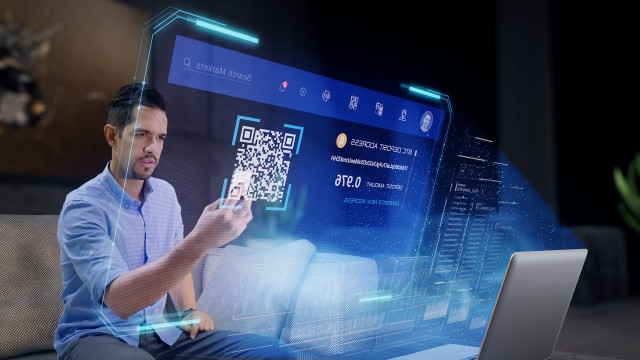 Man making a Bitcoin Deposit Transaction to his Cryptocurrency Wallet on Futuristic Holographic Interface.