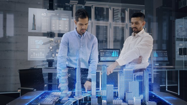 Professional Architects work with Holographic Augmented Reality 3D City Model using gestures.