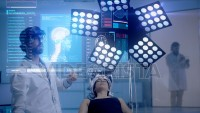 Doctor analyzing CT/ MRI Brain Scan Images on a futuristic augmented reality lens in cool ambient.