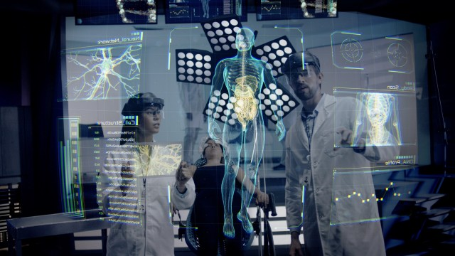 Doctor analyzing Body and DNA Scan Images on a futuristic augmented reality lens.
