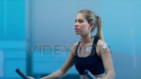 In Science High-Tech Sports Lab Beautiful Athlete Woman walks on treadmill using electrodes attached to her body. Close Up. Slow Motion. Shot on ARRI ALEXA Mini UHD Camera.