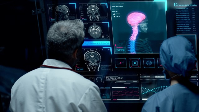 Surgeons Analyze Possible Brain Tumor In a Futuristic Digital Screen.