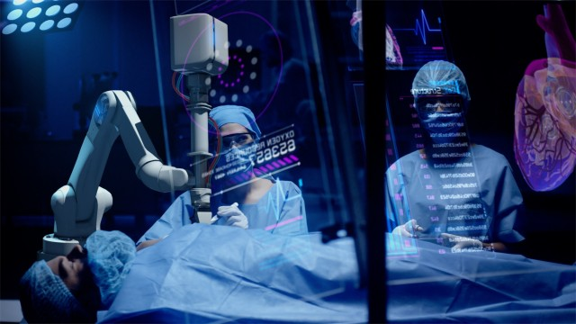 Team of surgeons perform a delicate operation using medical surgical robot while observing data on transparent screens. Modern medical equipment. Robotic arm for minimal invasive surgery.