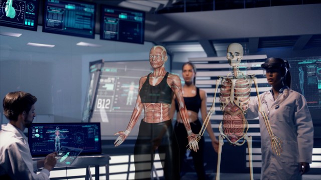 Scientists Analyze Athlete Diagnosis Data on Transparent Tablets and Real Scale Athlete Hologram Muscles. Shot on RED Epic-W Helium Camera.