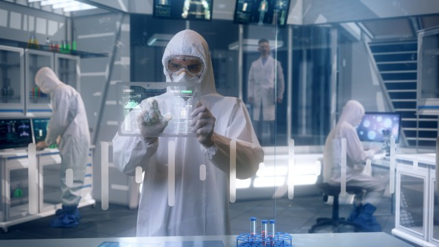 Inside Quarantine Secure High Level Laboratory Scientists in a Coverall Conducting a Research Trying to Make Coronavirus Disease Treatment.