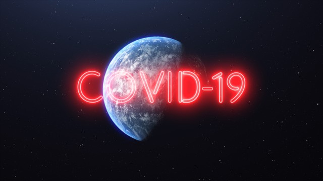 Covid-19 Red Neon Glowing Sign over the Earth. Flying away from Earth to Space showing Full Planet. Covid-19 Pandemic Asian Flu Outbreak