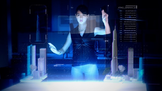 Professional Female Architect makes gestures and redesigns 3D City Model.