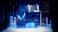 Professional Female Architect makes gestures and redesigns 3D City Model on Holographic Interface.