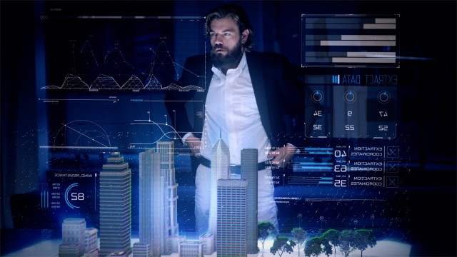 Professional Male Architect makes gestures and redesigns 3D City Model.