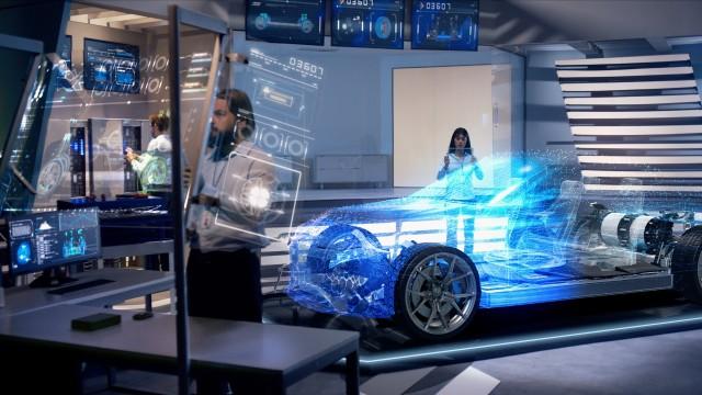 Engineers analyzing futuristic holographic car through a digital screen.