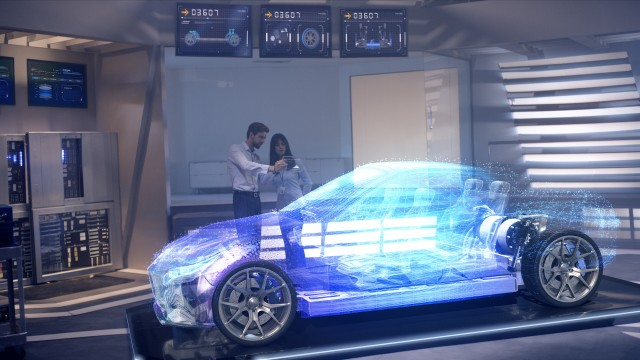 Engineers analyzing holographic futuristic car through a digital screen.