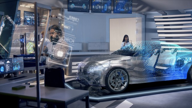 Engineers analyzing holographic futuristic detailed car through a digital screen.