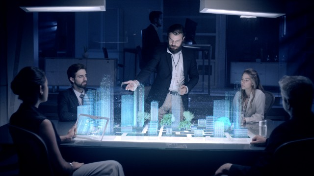 Professional Male Architect and Colleges makes gestures and redesigns 3D City Model in front of boardroom.
