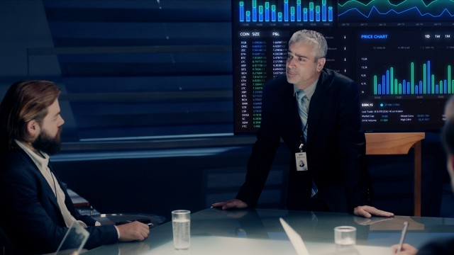 Corporate Meeting Room: Executive Director presents Exchange Trading Market Statistics and Financial Graphs to a Board of Executives. Shot on ARRI ALEXA Mini UHD Camera.