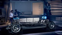 Female Engineer shows Electric Car Design Features to Client while wearing Holographic Headsets inside High-tech Industrial Facility. Concept of Augmented Reality. Shot on RED Epic W Helium 8K Camera.