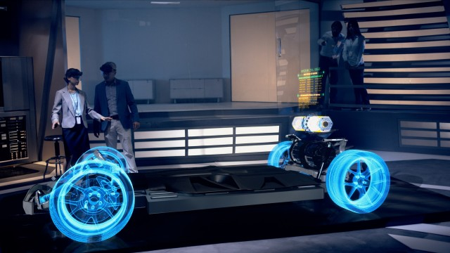 Female Engineer interacts with Hologram of Electric Car concept wearing Headset inside High-tech Industrial Facility. The Future of Augmented Reality with Graphs.
