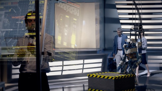 MIT Engineers Analyzing Design and Functionality of Futuristic Robot Prototype using Transparent Screens. Robot Jumps on top of Box. High-tech Industrial Facility. Shot on RED Epic W Helium.