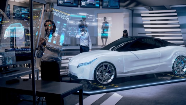 Engineers analyzing futuristic white car and futuristic with digital screens.