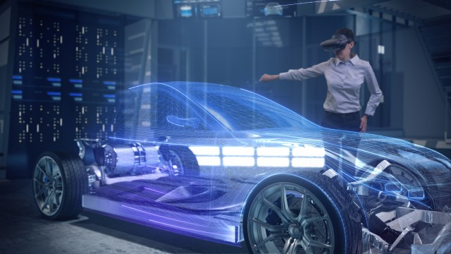 Automotive Female Professional Engineer working on design of Electric Car using Futuristic Augmented Reality Headset.