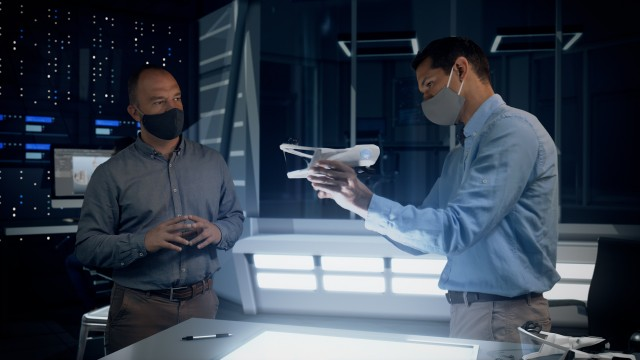 Professional Engineers and Designers Wearing Protective Face Masks Work with a Futuristic Face Mask Prototype Model for Covid-19 Coronavirus.