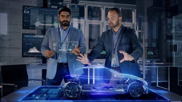 Professional Male Automotive Designers makes gestures and redesigns 3D Electric Concept Car Model